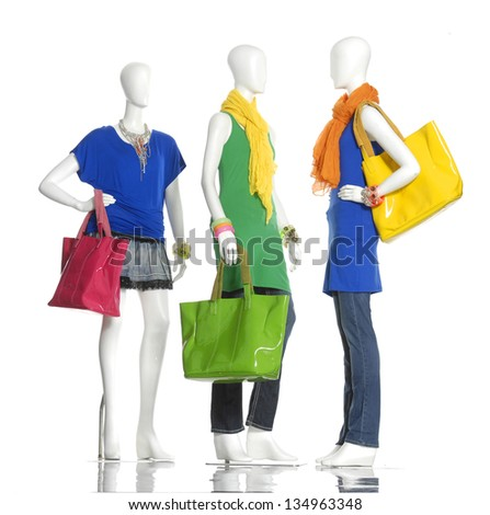 female dress with bag ,scarf on three mannequin - stock photo