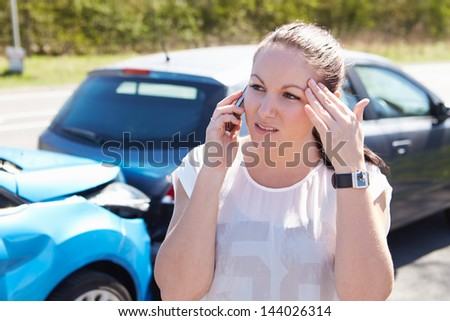Female Driver Making Phone Calls After Traffic Accident - stock photo