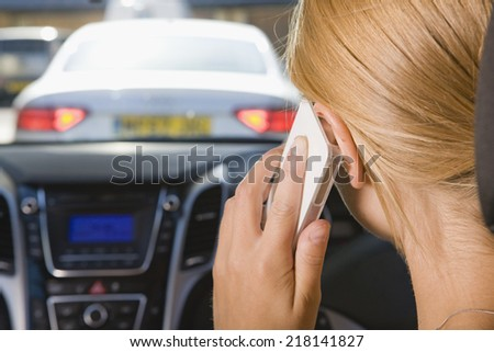 Female Driver Talking On Phone Whilst Driving