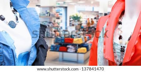 Female dummies inside a fashion clothing store - stock photo
