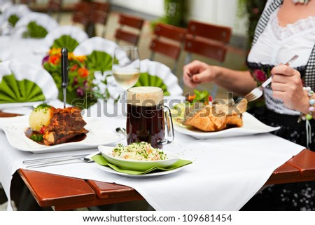 female eating at the oktoberfest - stock photo