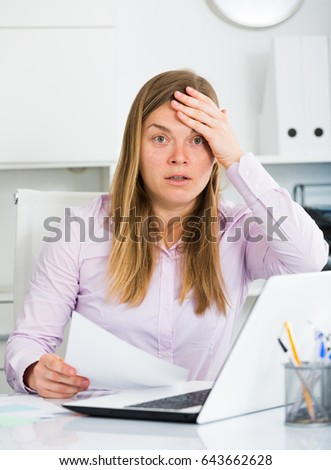 Female employee having complicated issue in project in office