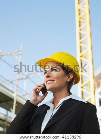 female engineer talking on mobile phone. Copy space - stock photo