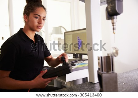 Female Engineer Using CAD System To Work On Component