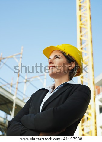 female engineer with arms folded looking away. Copy space