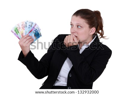 female entrepreneur holding bunch of bank notes - stock photo