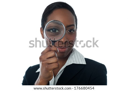 Female executive looking through lens