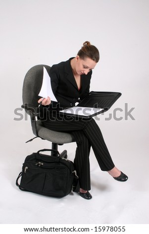 Female executive looking through papers