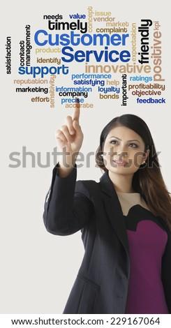 "Female Executive press virtual Screen-""Custom er Service"" word cloud arrangement""  - stock photo"