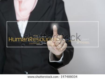 "Female Executive press virtual Screen-""Human Resources"" word cloud arrangement"" - stock photo"