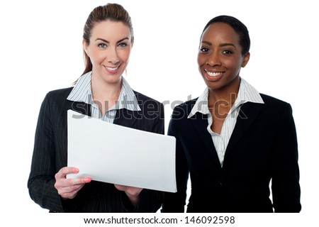 Female executives with financial document