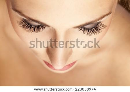 female face and eyes with false eyelashes - stock photo