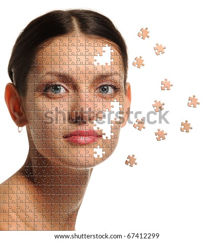 Female face close up and details puzzle. It is isolated on a white background - stock photo