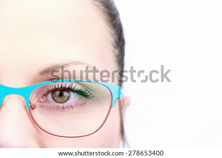 Female face closeup on eye with glasses isolated on white background - stock photo