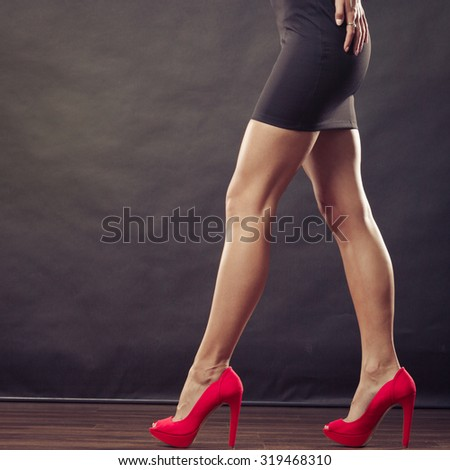 Female fashion. Closeup red high heels spiked fashionable shoes on sexy female legs - stock photo