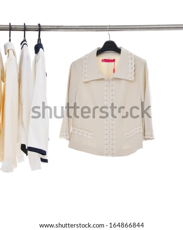 female fashion clothing, jacket on hangers at the show