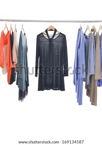 female fashion clothing with jacket on hangers at the show