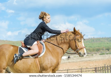 female fashion model and horse outdoor shot