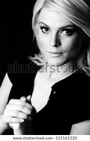 female fashion model, blond hair, black and white - stock photo