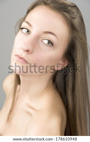 female fashion model blond hair,head shot portrait, long hair, white skin ,light green eyes, naked shoulders