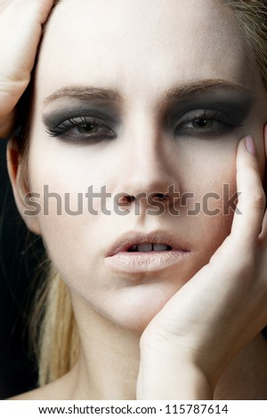 female fashion model head shot at dark background - stock photo