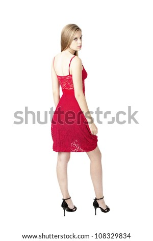 female fashion model posing at red dress at white background ,isolated - stock photo