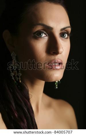 female fashion model wearing traditional Indian Jewelry - stock photo