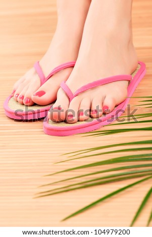 Female feet in pink sandals