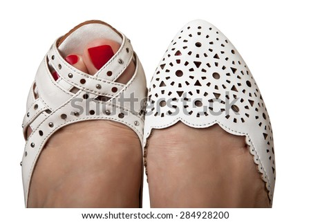 Female feet in summer shoes white - stock photo