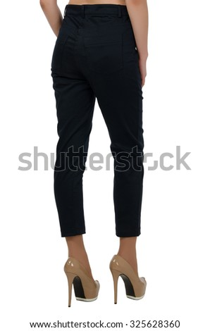 Female feet in the pants isolated on white