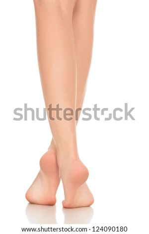 Female feet isolated on white background - stock photo