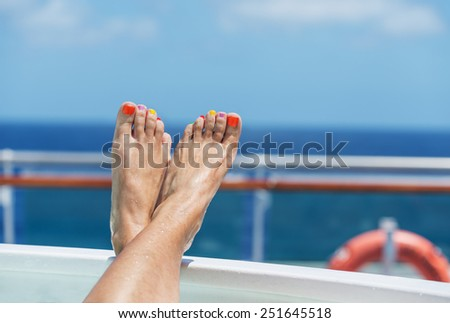female feet on board a cruise ship - the concept of a cruise vacation - stock photo
