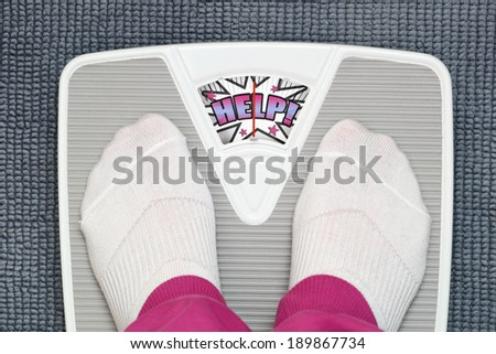 Female feet on funny bathroom scale - stock photo
