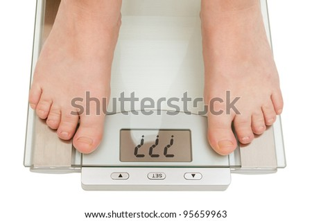 Female feet on scales isolated on white - Question Marks on Display - stock photo