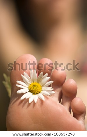 female feet with flower - stock photo