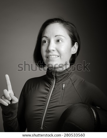 Female fencer pointing her finger up - stock photo