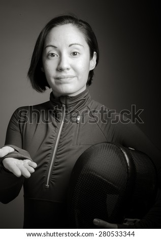 Female fencer presenting something - stock photo