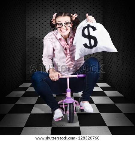 Female Financial Controller Withdrawing Money From A Bank Safe Vault In A Quirky Depiction Of A Business Banking Transaction - stock photo