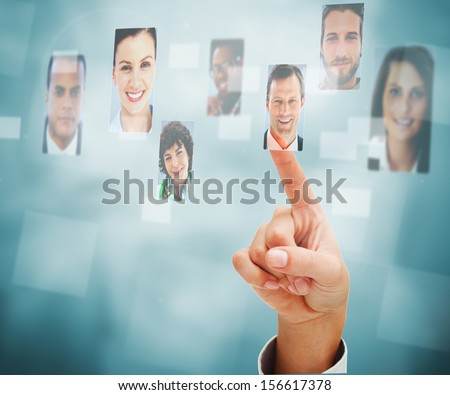 Female finger selecting profile picture on digital interface - stock photo