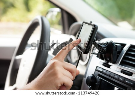 Female finger typing on gps. - stock photo