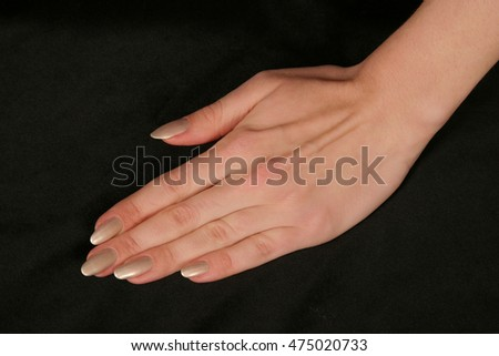 female fingers hands on black background