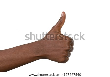 Female fist thumbs up, studio shot, isolated - stock photo