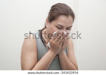 Female flu sneeze. - stock photo