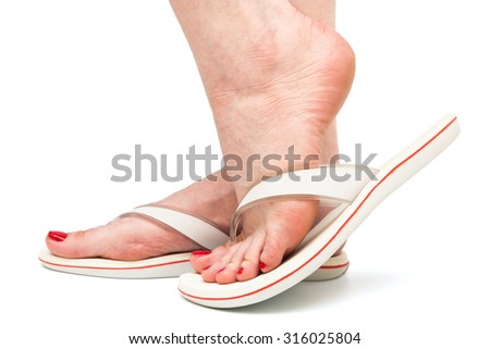 female foot in sandal on a white background - stock photo