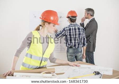 female foreman during a meeting about a build project - stock photo