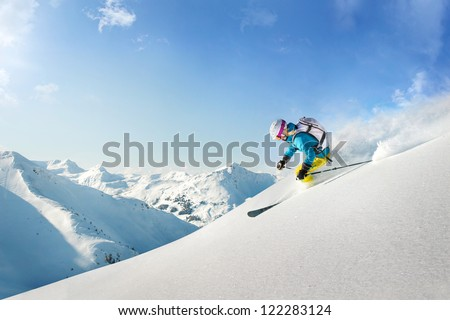 Female freeride skier - stock photo