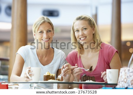 Female Friends Having Lunch Together At The Mall - stock photo