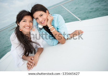 Female friends on a yacht looking very happy