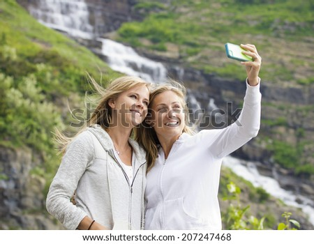 Female Friends taking selfie at a national park - stock photo