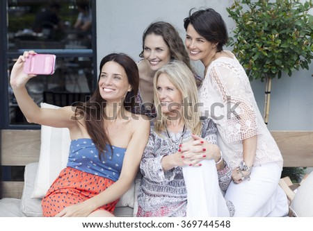 Female Friends Taking Selfie Outdoors - stock photo